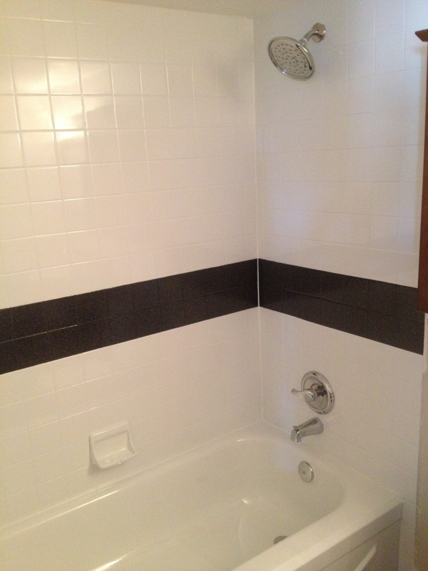 After-Black Stripe Bathtub Tile Surround